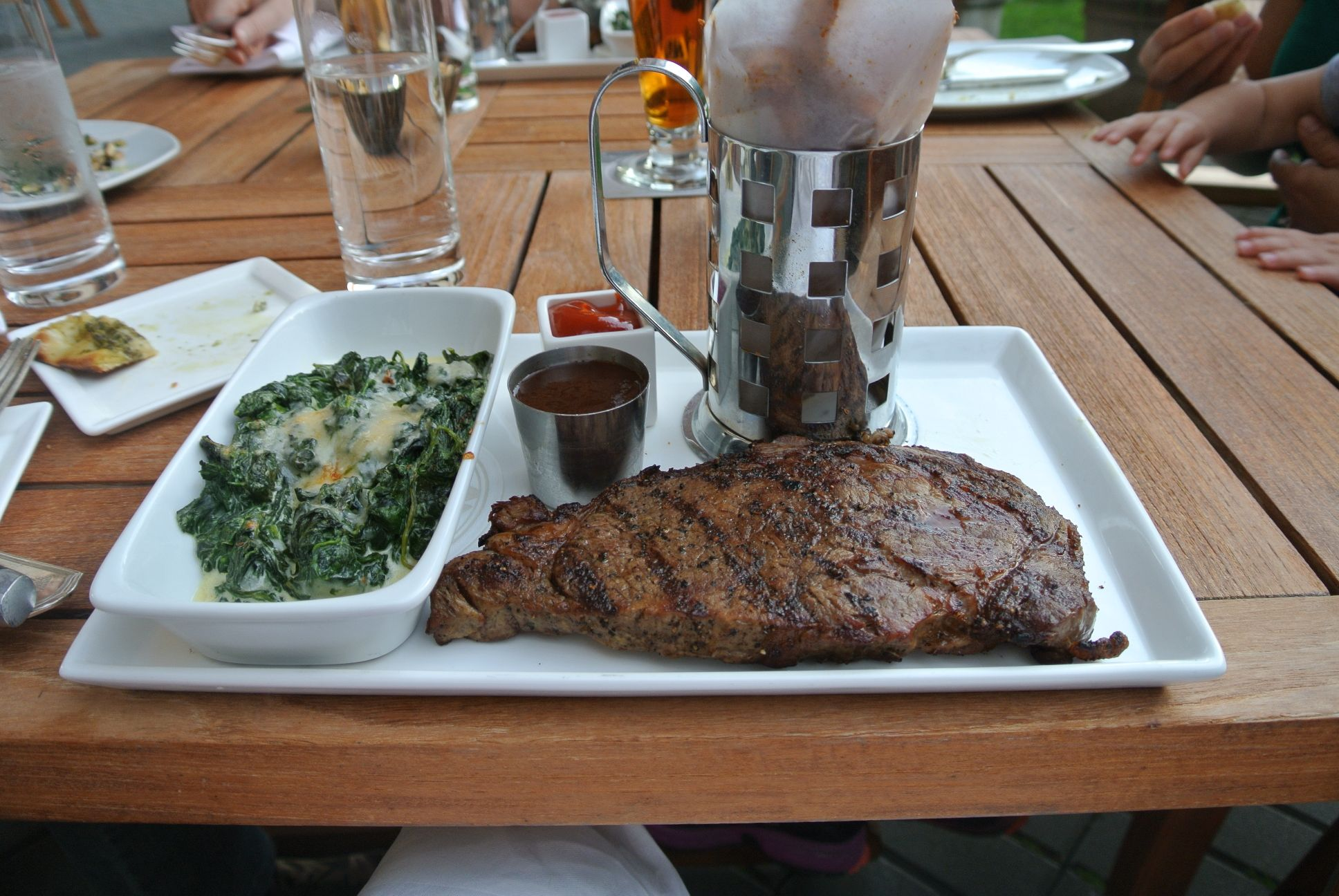 12oz Grilled Angus Ribeye, Hand Cut Spicy Fries, Spinach, Gratin, E2 Sauce