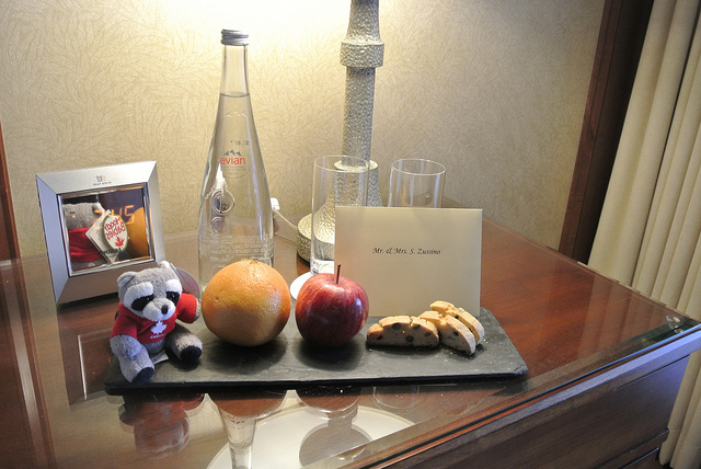 Four Seasons Whistler Welcome Gift - Stuffed Animal, water, fruit, and biscotti.